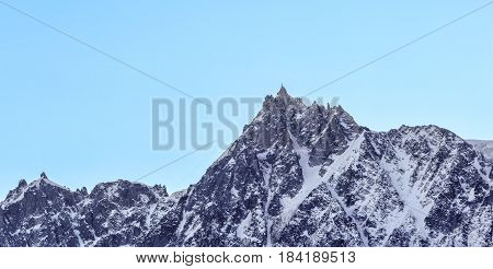 Winter image of Aiguille du Midi (3842m) in Mont Blanc Massif.