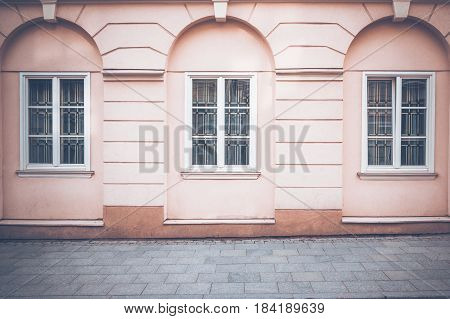 Classical building wall with windows and pavement as as architectural background