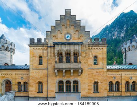 Ancient clock in the inner courtyard of the Neuschwanstein castle in the Bavaria Alps, Germany