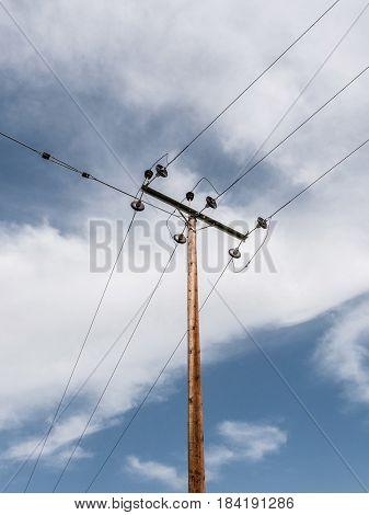 Electricity high voltage wooden power pole.Conceptual photo