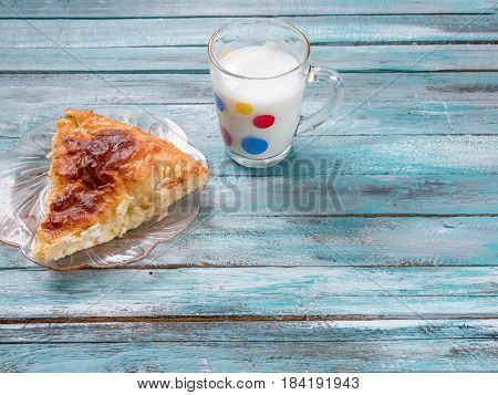 Traditional Bulgarian cheese pastry Banitsa on an wooden table with Greek yogurt