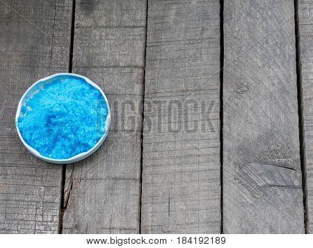Bright blue copper sulfate CuSO4 also blue vitriol or bluestone. Salt used as algicide in swimming pools for fireworks and in schools to grow crystals.