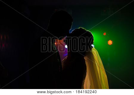 The bride and groom dancing on the dancefloor