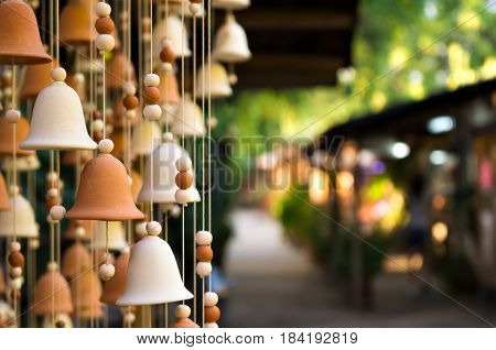 Hand made wind chimes hanging on a string with depth of field effect