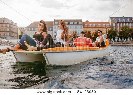 Teenagers Relaxing On Boat In The Lake
