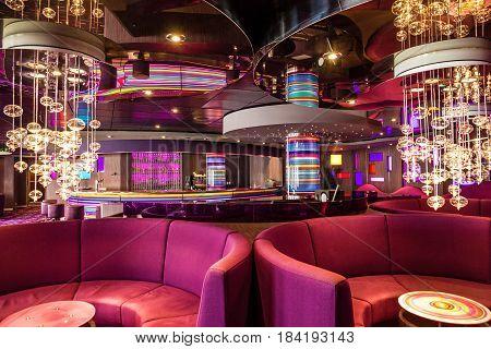 Cruise liner Costa Mediterranea - April 4, 2017: Red sofa in bar interior on cruise liner Costa Mediterranea.