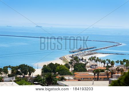 Beautiful view of Long Beach coastline with pier and levee, United States