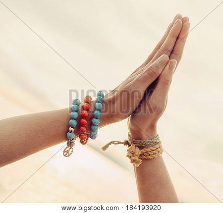 Female hands together close-up gesture namaste yoga praying.