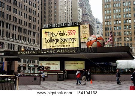 New York USA - November 13 2008: entrance marquee of madison square garden arena with billboards and grey buildings in midtown manhattan on cityscape background. Entertainment and landmark