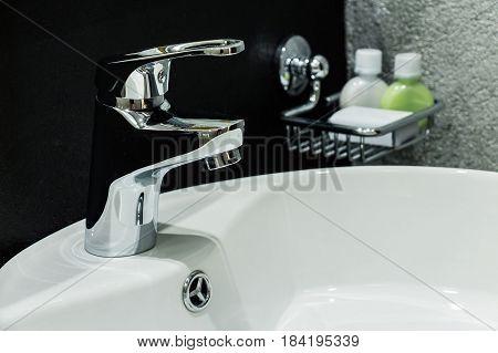 Modern bathroom washbasin with chrome water tap