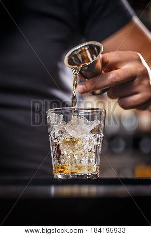 Barman Is Pouring Alcohol From A Jigger