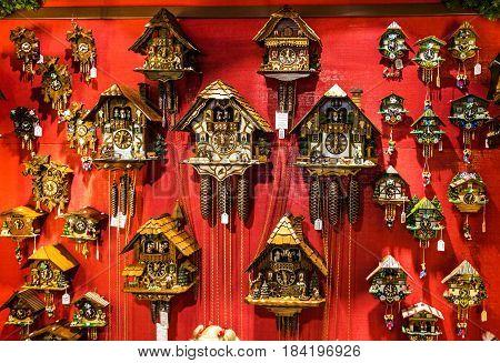 Munich, Germany - May 1, 2017: Vintage wooden cuckoo clocks in shop Munich, Germany