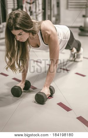 Young Woman Doing Dumbbell Pushups