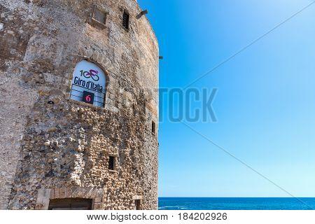 Alghero Italy - April 29 2017: Giro d'Italia banner on a historic sighting tower