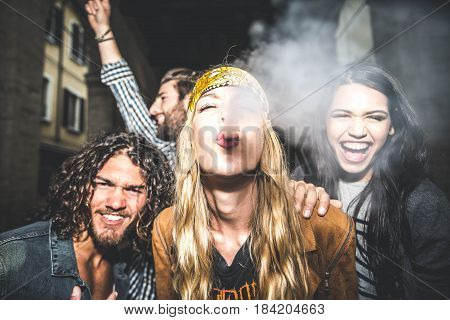 Group of friends making party outdoor in the night