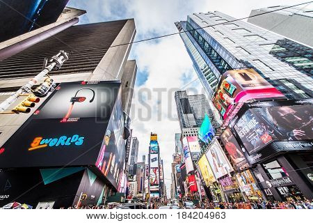 NEW YORK CITY NY - NOVEMBER 25 2015: Times Square is featured with Broadway Theaters and LED signs as a symbol of New York City and the United States September 5 2009 in Manhattan New York City.
