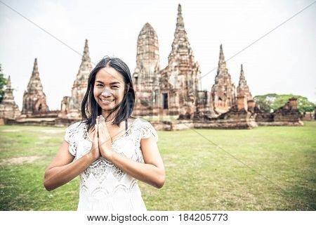 Young woman praying at Ayutthaya Historical Park