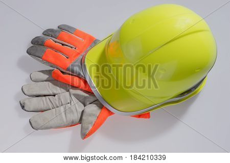 Yellow helmet work and protective gloves isolated