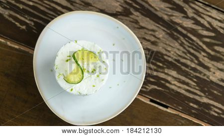 Lime frozen souffle on wooden background , Food background
