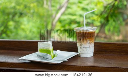 Caramel macchiato with young coconut cake on nature background