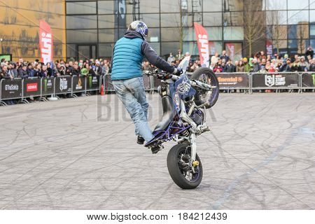 St. Petersburg Russia - 15 April, Doing tricks on a bike,15 April, 2017. International Motor Show IMIS-2017 in Expoforurum. Sports motorcycle show of bikers on the open area.