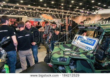 St. Petersburg Russia - 15 April, Guys at an off-road car,15 April, 2017. International Motor Show IMIS-2017 in Expoforurum. Visitors and participants of the annual moto-salon in St. Petersburg.