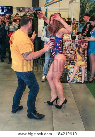 St. Petersburg Russia - 15 April, Dancing erotic dance,15 April, 2017. International Motor Show IMIS-2017 in Expoforurum. Erotic dances of the girls at the motor show.