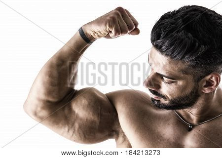 Closeup of bodybuilder man flexing muscular bicep, isolated on white background