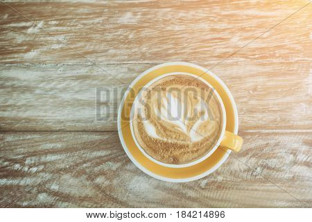 Beautiful Latte Art On Wooden Table For Hot Coffee Latte