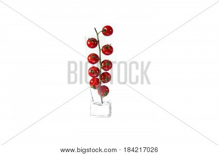 Cherry tomat in a glass, and isoalted on white