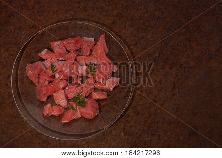 Raw Cubes Of Meat To Prepare Goulash On Glass Plate