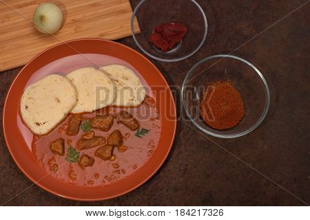 Traditional Goulash Wit Dumplings And Ingredients For This Food.