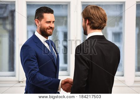 Boss And Employee Shaking Hands To Seal Deal With Partner.