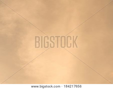 Soft orange sky with cloud in background.