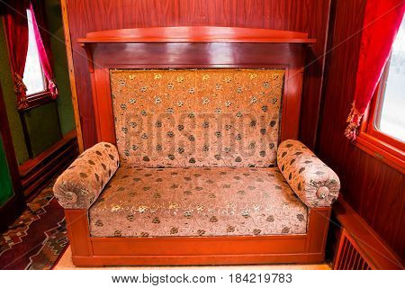 Vintage old sofa in the compartment interior. Old luxury wagon in a train