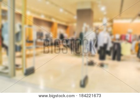 Blur People Shopping In Super Store With Bokeh Light Background.