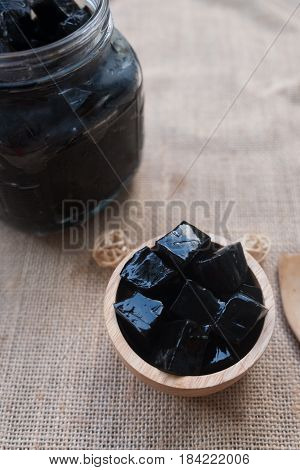 Grass jelly or vegetable jelly in wooden bowl Thai style sweet