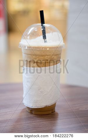 ice coffee frappe with straw in plastic cup
