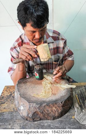 Man During The Manufacture Of A Wayang Kulit