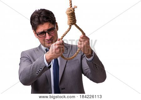 Bankrupt businessman hanging himself isolated on white
