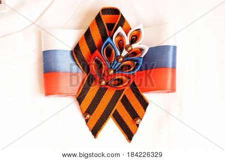 Festive brooch with a St.George's Ribbon on a Victory Day