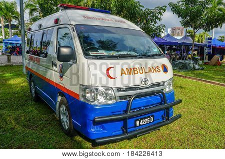 Labuan,Malaysia-Apr 29,2017:A Toyota Ambulance of the Malaysia Civil Defence Force van parked on street during town fiesta in Labuan,Malaysia.To call an ambulance anywhere in Malaysia dial 999.