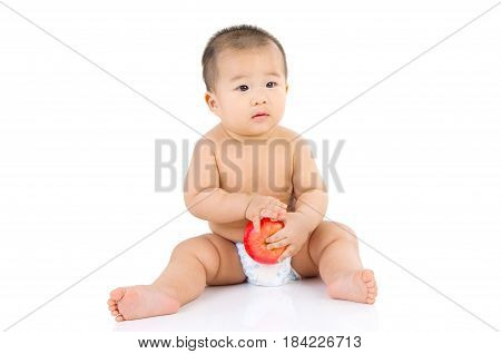 cute asian baby sitting on the floor isolated on white background