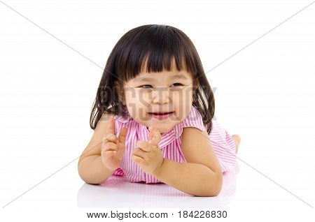 beautiful baby girl smilling and crawling on the floor