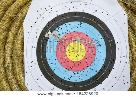 Archery Target With Arrows On a straw background