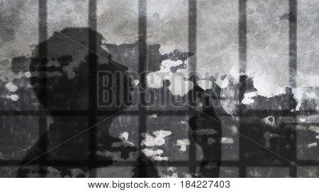 Man Shadow Smoking Under Jail Bars. Nicotine Dependence Metaphor.