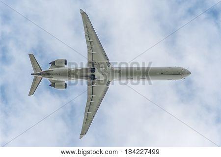 under a twin engine big jet plane