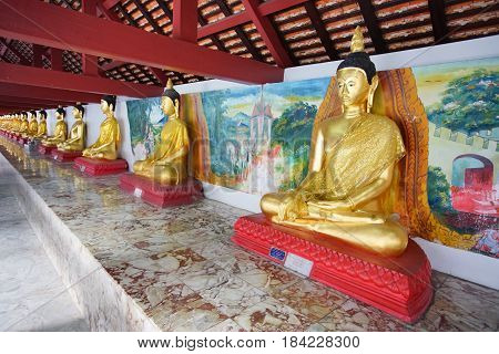 NAKHON SI THAMMARAT THAILAND - April 12 2017: A lot of Bhudha statues in Wat Phra Mahathat Woramahawihan temple. This temple is the main Buddhist temple (wat) of the Nakhon Si Thammarat Province in Southern Thailand.