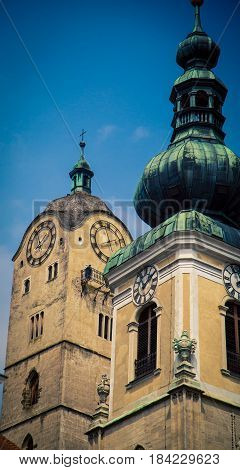 Clock tower and church dome in Krems Austria
