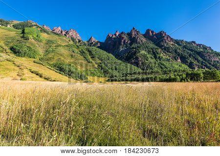 Mountain view from Maroon Bells lake near Aspen Colorado